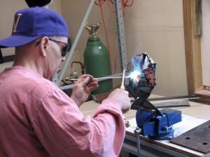 An acetylene torch melts the steel.