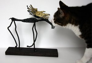 The tiger cat and the moose sculpture.